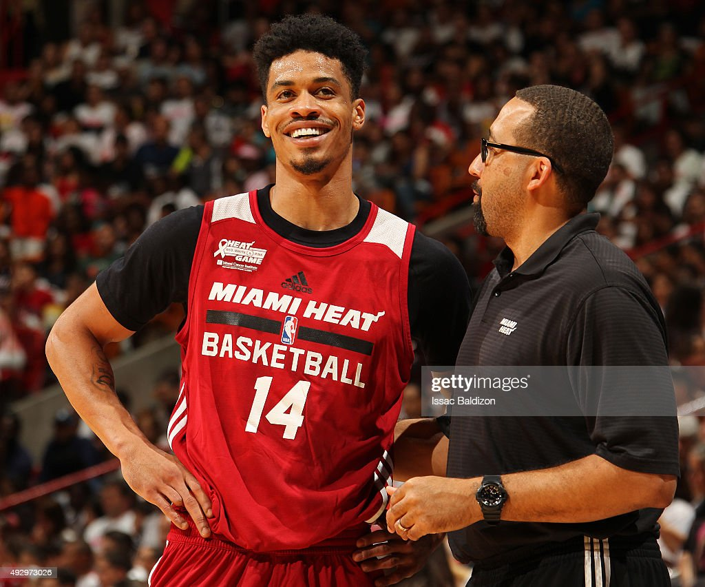 David Fizdale and Josh Richardson #14 of the Miami Heat smile and talk during a scrimmage game for the public at the American Airlines Arena in Miami, Florida on October 15, 2015.