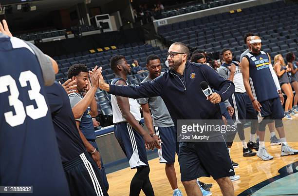 David Fizdale of the Memphis Grizzlies high fives teammates during an open practice on October 1 2016 at FedExForum in Memphis Tennessee NOTE TO USER...