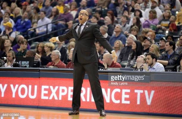David Fizdale the head coach of the Memphis Grizzlies gives instructions to his team against the Indiana Pacers during the game at Bankers Life...
