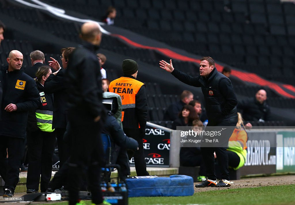 David Flitcroft, Manager of Barnsley speaks with a steward and gestures after taunts from the home support during the FA Cup with Budweiser Fifth Round match between MK Dons and Barnsley at StadiumMK on February 16, 2013 in Milton Keynes, England.