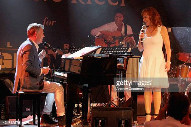 David Foster and Reba McEntire perform at the White Party Dinner Hosted by Andrea and Veronica Bocelli Celebrating Celebrity Fight Night In Italy...