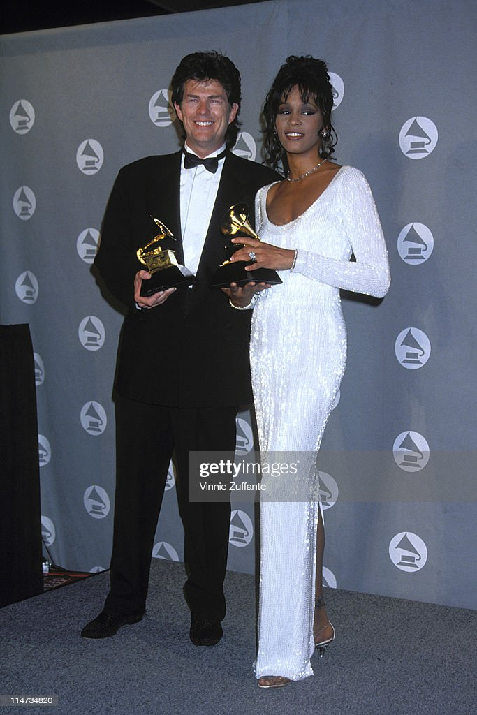 David Foster with Whitney Houston in the press room at the 1994 Grammy Awards in NYC