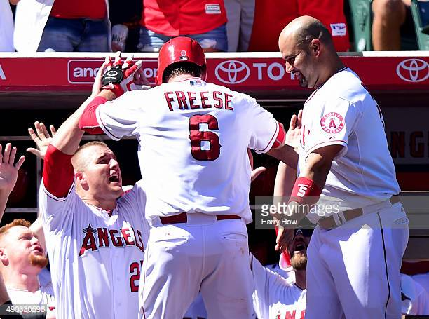 David Freese of the Los Angeles Angels celebrates his solo homerun with Mike Trout and Albert Pujols to take a 21 lead over the Seattle Mariners...