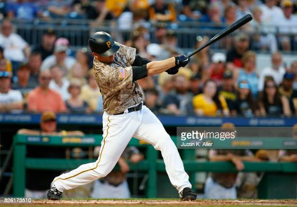 David Freese of the Pittsburgh Pirates hits an RBI single in the third inning against the Cincinnati Reds at PNC Park on August 3 2017 in Pittsburgh...