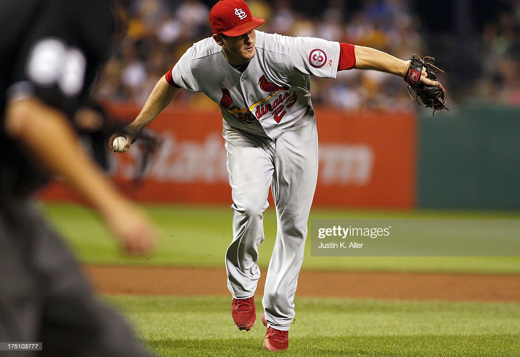 <a gi-track='captionPersonalityLinkClicked' href=/galleries/search?phrase=David+Freese+-+Baseball+Player&family=editorial&specificpeople=4948315 ng-click='$event.stopPropagation()'>David Freese</a> #23 of the St. Louis Cardinals fields a bunt in the fifth inning against the Pittsburgh Pirates during the game on July 31, 2013 at PNC Park in Pittsburgh, Pennsylvania.