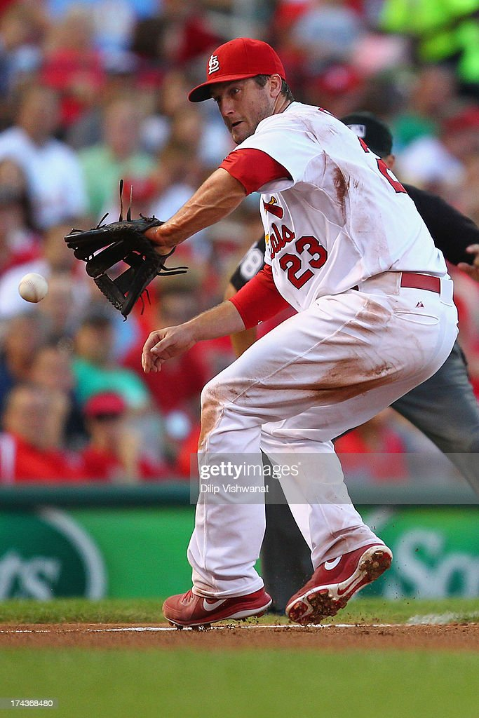 <a gi-track='captionPersonalityLinkClicked' href=/galleries/search?phrase=David+Freese+-+Baseball+Player&family=editorial&specificpeople=4948315 ng-click='$event.stopPropagation()'>David Freese</a> #23 of the St. Louis Cardinals fields a line drive against the Philadelphia Phillies in the third inning at Busch Stadium on July 24, 2013 in St. Louis, Missouri.