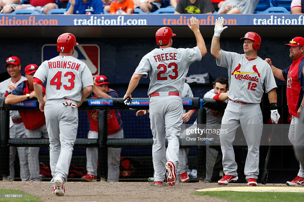 <a gi-track='captionPersonalityLinkClicked' href=/galleries/search?phrase=David+Freese+-+Baseball+Player&family=editorial&specificpeople=4948315 ng-click='$event.stopPropagation()'>David Freese</a> #23 of the St. Louis Cardinals is congratulated by his teammate (R) <a gi-track='captionPersonalityLinkClicked' href=/galleries/search?phrase=Ty+Wigginton&family=editorial&specificpeople=211533 ng-click='$event.stopPropagation()'>Ty Wigginton</a> #12 of the St. Louis Cardinals as he and (L) Shane Robinson #43 of the St. Louis Cardinals score in the fourth inning against the New York Mets at Tradition Field on February 27, 2013 in Port St. Lucie, Florida.