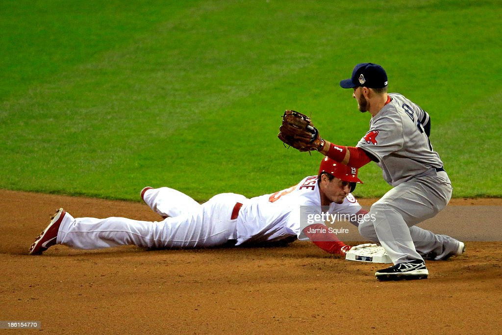 David Freese #23 of the St. Louis Cardinals is safe at second against Stephen Drew #7 of the Boston Red Sox in the eighth inning of Game Five of the 2013 World Series at Busch Stadium on October 28, 2013 in St Louis, Missouri.