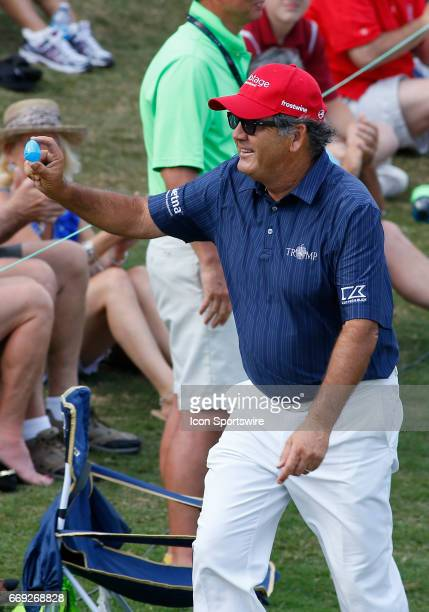 David Frost hands an easter egg to a lucky fan after he completes the final round of the Mitsubishi Electric Classic tournament at the TPC Sugarloaf...