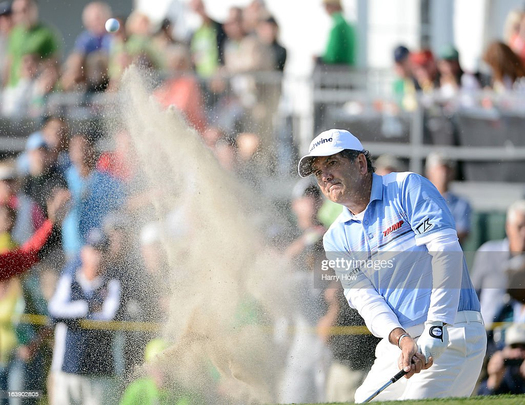 David Frost of South Africa hits out of the bunker on the 18th hole on his way to a five shot win and a 19 under par score during the final round of the Toshiba Classic at the Newport Beach Country Club on March 17, 2013 in Newport Beach, California.