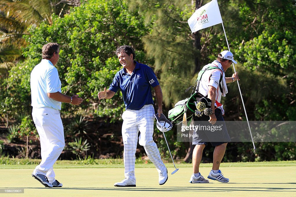 David Frost of South Africa is congratulated by <a gi-track='captionPersonalityLinkClicked' href=/galleries/search?phrase=Barry+Lane&family=editorial&specificpeople=206428 ng-click='$event.stopPropagation()'>Barry Lane</a> of England on the 18th green during the final round of the MCB Tour Championship played at the Legends Course, Constance Belle Mare Plage on December 9, 2012 in Poste de Flacq, Mauritius.