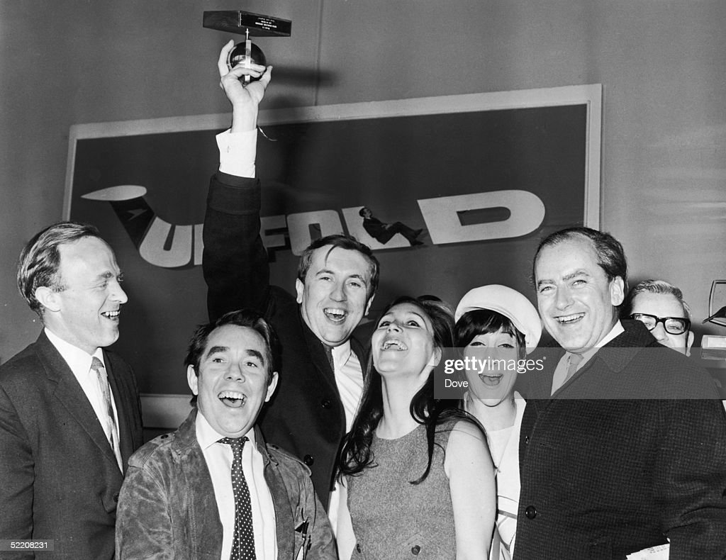 David Frost with other cast members of the television comedy programme 'Frost Over England' at London Airport after the show won the Golden Rose...