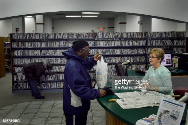 David Fuller III chats with a librarian at the New Madrid County Library in the small town where he now lives on Sunday February 13 2017 in...