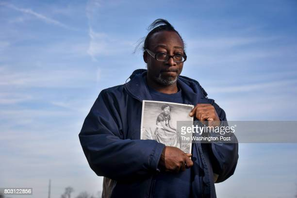 David Fuller III holds a portrait of his mother as a 16yearold teenager on Sunday February 12 2017 in Portageville MO David's mother Catherine Fuller...