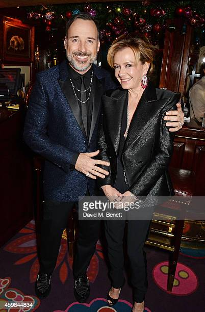 David Furnish and Caroline Scheufele Artistic Director and CoPresident of Chopard attend the Chopard Christmas Party at Annabel's on December 2 2014...