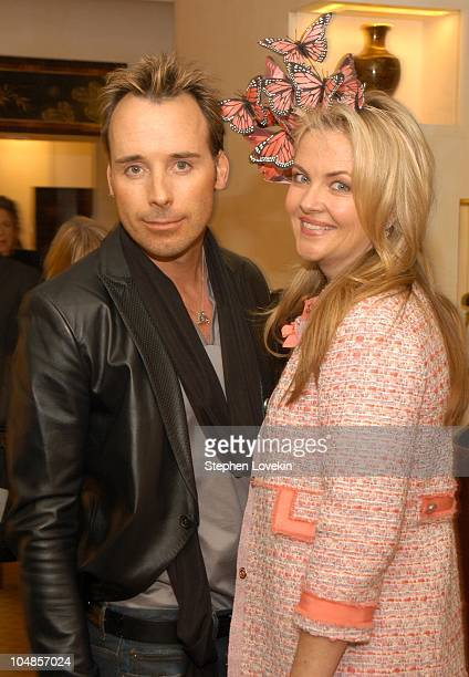 David Furnish and Cornelia Guest in a Philip Treacy hat