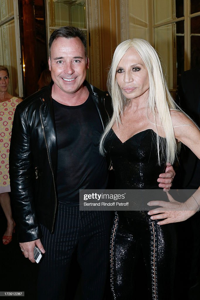<a gi-track='captionPersonalityLinkClicked' href=/galleries/search?phrase=David+Furnish&family=editorial&specificpeople=220203 ng-click='$event.stopPropagation()'>David Furnish</a> and Donnatella Versace backstage at Versace show as part of Paris Fashion Week Haute-Couture Fall/Winter 2013-2014 at on June 30, 2013 in Paris, France.