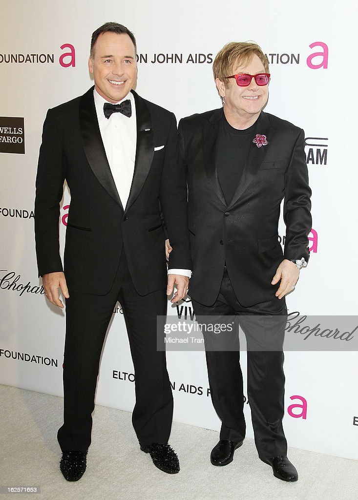David Furnish (L) and Elton John arrive at the 21st Annual Elton John AIDS Foundation Academy Awards viewing party held at West Hollywood Park on February 24, 2013 in West Hollywood, California.