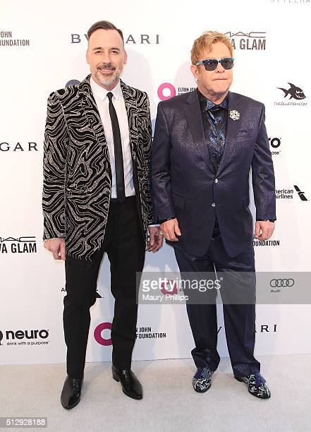 David Furnish and Elton John attend the 24th Annual Elton John AIDS Foundation's Oscar Viewing Party Arrivals on February 28 2016 in West Hollywood...