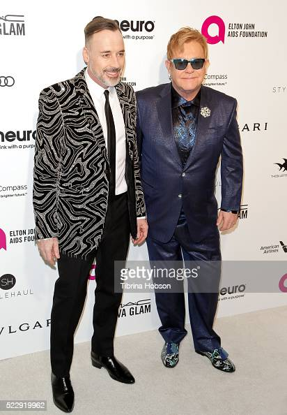 David Furnish and Elton John attend the 24th annual Elton John AIDS Foundation's Oscar Party on February 28 2016 in West Hollywood California