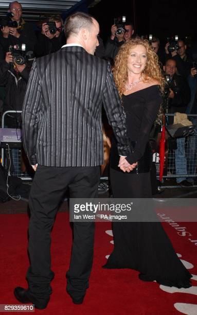 David Furnish and Kelly Hoppen arrive for the world charity premiere of Alfie at the Empire Leicester Square in central London in aid of MakeAWish...