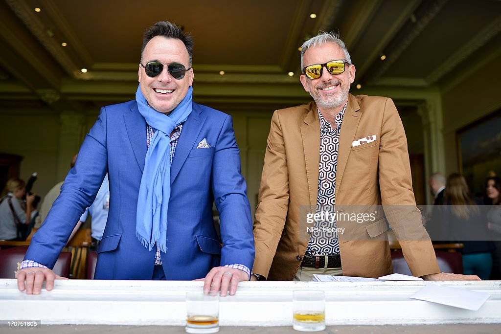 David Furnish (L) and Patrick Cox attend the Savile Row & St James' Presentation during the London Collections: MEN SS14 at Lord's Cricket Ground on June 17, 2013 in London, England.