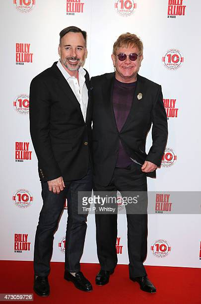 David Furnish and Sir Elton John arrive for the 10 Year Anniversary performance of Billy Elliot at Victoria Palace Theatre on May 12 2015 in London...