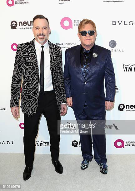 David Furnish and Sir Elton John attend the 24th Annual Elton John AIDS Foundation's Oscar Viewing Party on February 28 2016 in West Hollywood...