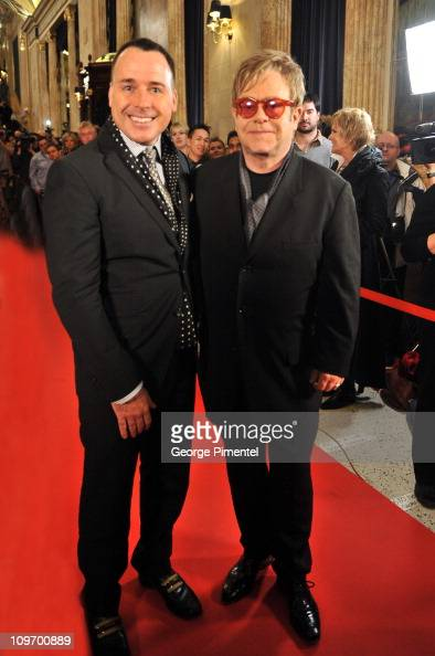 David Furnish and Sir Elton John attend the Canadian Premiere of Billy Elliot The Musical at the Canon Theatre on March 1 2011 in Toronto Canada