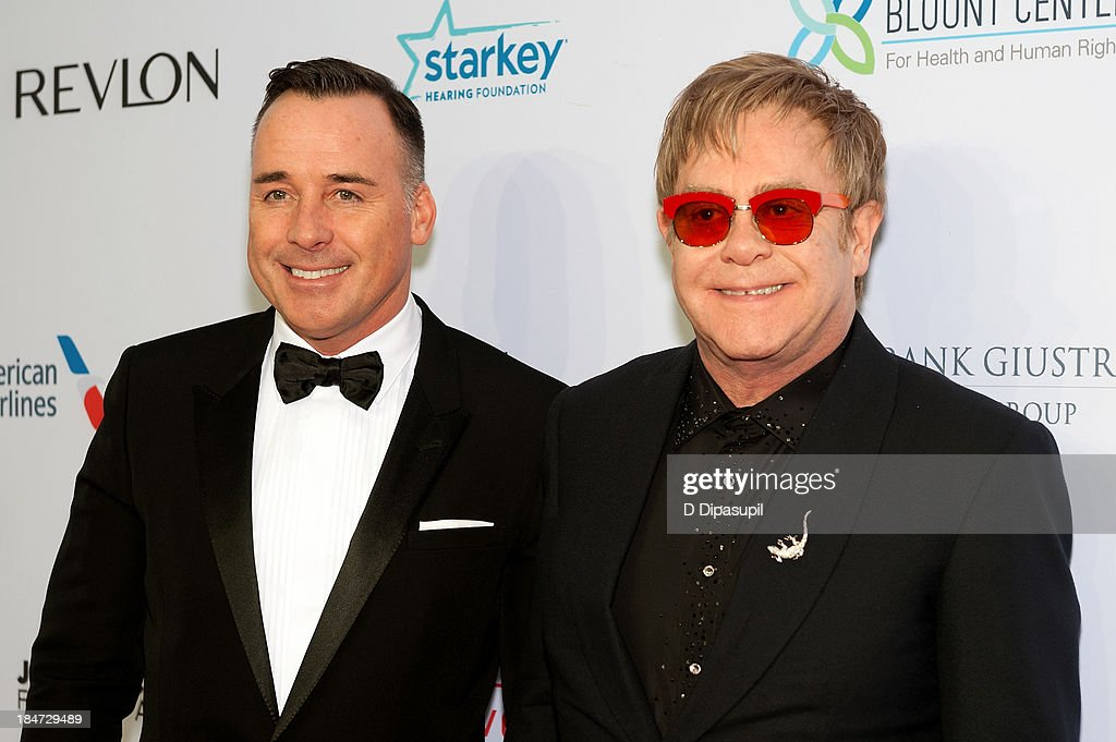 <a gi-track='captionPersonalityLinkClicked' href=/galleries/search?phrase=David+Furnish&family=editorial&specificpeople=220203 ng-click='$event.stopPropagation()'>David Furnish</a> (L) and Sir <a gi-track='captionPersonalityLinkClicked' href=/galleries/search?phrase=Elton+John&family=editorial&specificpeople=171369 ng-click='$event.stopPropagation()'>Elton John</a> attend the <a gi-track='captionPersonalityLinkClicked' href=/galleries/search?phrase=Elton+John&family=editorial&specificpeople=171369 ng-click='$event.stopPropagation()'>Elton John</a> AIDS Foundation's 12th Annual An Enduring Vision Benefit at Cipriani Wall Street on October 15, 2013 in New York City.