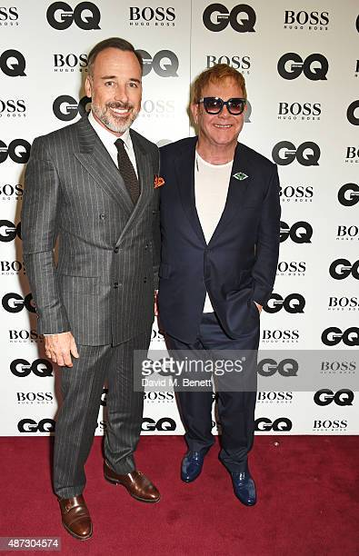 David Furnish and Sir Elton John attend the GQ Men Of The Year Awards at The Royal Opera House on September 8 2015 in London England