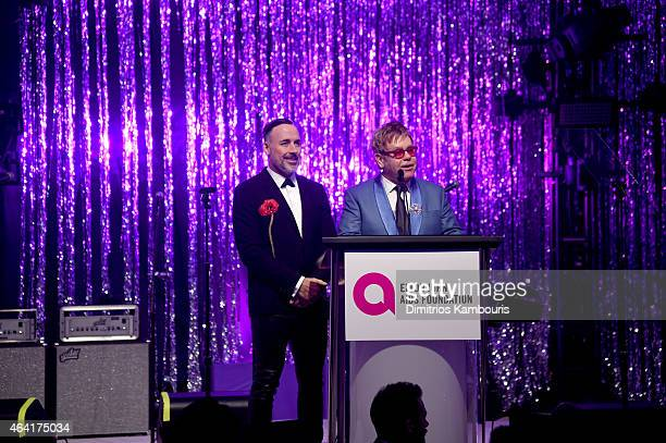 David Furnish and Sir Elton John speak onstage during the 23rd Annual Elton John AIDS Foundation Academy Awards Viewing Party on February 22 2015 in...