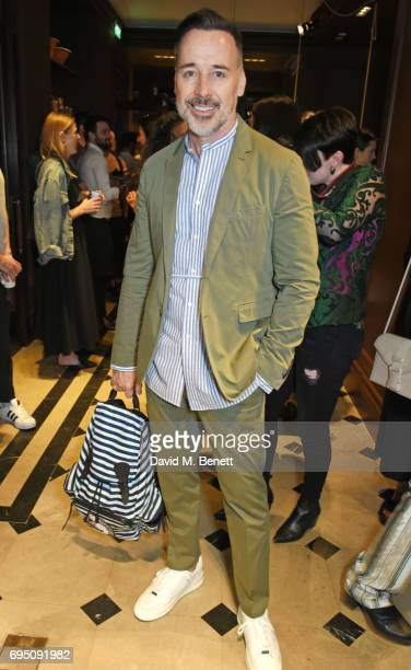 David Furnish attends a breakfast hosted by Christopher Bailey Dame Natalie Massenet and Dylan Jones in celebration of London Fashion Week Men's at...