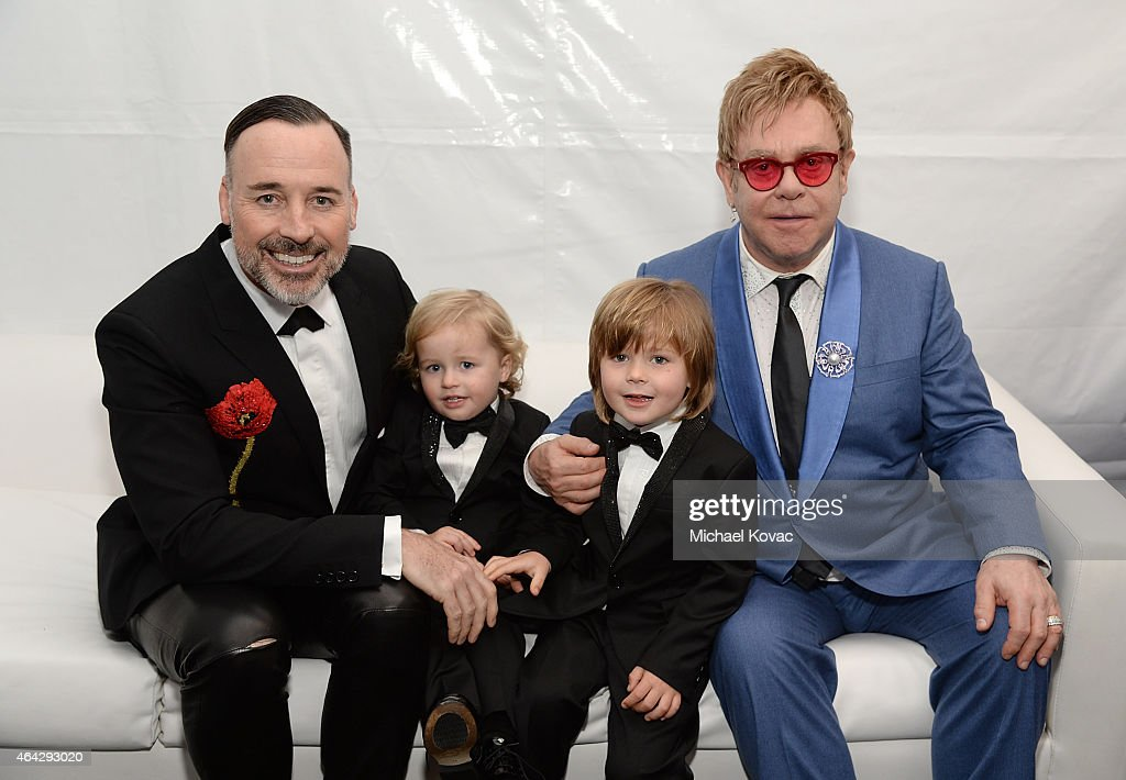 <a gi-track='captionPersonalityLinkClicked' href=/galleries/search?phrase=David+Furnish&family=editorial&specificpeople=220203 ng-click='$event.stopPropagation()'>David Furnish</a>, Elijah Furnish-John, <a gi-track='captionPersonalityLinkClicked' href=/galleries/search?phrase=Zachary+Furnish-John&family=editorial&specificpeople=10510452 ng-click='$event.stopPropagation()'>Zachary Furnish-John</a>, and Sir <a gi-track='captionPersonalityLinkClicked' href=/galleries/search?phrase=Elton+John&family=editorial&specificpeople=171369 ng-click='$event.stopPropagation()'>Elton John</a> attend the 23rd Annual <a gi-track='captionPersonalityLinkClicked' href=/galleries/search?phrase=Elton+John&family=editorial&specificpeople=171369 ng-click='$event.stopPropagation()'>Elton John</a> AIDS Foundation Academy Awards Viewing Party on February 22, 2015 in Los Angeles, California.
