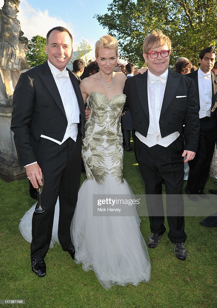 (L-R) <a gi-track='captionPersonalityLinkClicked' href=/galleries/search?phrase=David+Furnish&family=editorial&specificpeople=220203 ng-click='$event.stopPropagation()'>David Furnish</a>, <a gi-track='captionPersonalityLinkClicked' href=/galleries/search?phrase=Naomi+Watts&family=editorial&specificpeople=171723 ng-click='$event.stopPropagation()'>Naomi Watts</a> and <a gi-track='captionPersonalityLinkClicked' href=/galleries/search?phrase=Elton+John&family=editorial&specificpeople=171369 ng-click='$event.stopPropagation()'>Elton John</a> all are wearing Chopard as they attend The 14th Annual White Tie and Tiara Ball to Benefit <a gi-track='captionPersonalityLinkClicked' href=/galleries/search?phrase=Elton+John&family=editorial&specificpeople=171369 ng-click='$event.stopPropagation()'>Elton John</a> AIDS Foundation in Association with Chopard at Woodside on June 28, 2012 in Windsor, England. NO UK SALES BEFORE 17TH JULY 2012. NO HELLO, NOW, CLOSER, REVEAL, HEAT, LOOK OR GRAZIA SALES IN THE UK EVER. NO ITALY SALES BEFORE 4TH JULY 2012, NO SPAIN SALES BEFORE 7TH JULY 2012, NO MEXICO SALES BEFORE 1ST AUGUST 2012. All pictures are for editorial use only and mention of 'Chopard' and 'The <a gi-track='captionPersonalityLinkClicked' href=/galleries/search?phrase=Elton+John&family=editorial&specificpeople=171369 ng-click='$event.stopPropagation()'>Elton John</a> Aids Foundation' are compulsory. No sales ever to any jewellers other than Chopard