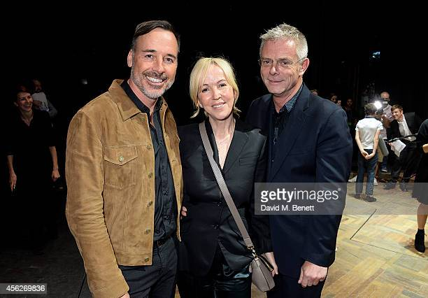 David Furnish Sally Greene and Stephen Daldry pose backstage following the curtain call for Billy Elliot The Musical Live at the Victoria Palace...