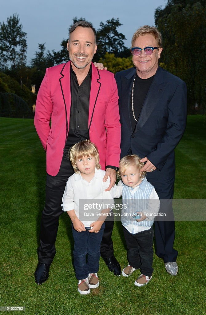 APPLIES. (L to R) <a gi-track='captionPersonalityLinkClicked' href=/galleries/search?phrase=David+Furnish&family=editorial&specificpeople=220203 ng-click='$event.stopPropagation()'>David Furnish</a>, Zachary Furnish-John, Elijah Furish-John and Sir <a gi-track='captionPersonalityLinkClicked' href=/galleries/search?phrase=Elton+John&family=editorial&specificpeople=171369 ng-click='$event.stopPropagation()'>Elton John</a> attend the Woodside End of Summer party to benefit the <a gi-track='captionPersonalityLinkClicked' href=/galleries/search?phrase=Elton+John&family=editorial&specificpeople=171369 ng-click='$event.stopPropagation()'>Elton John</a> AIDS Foundation sponsored by Chopard and Grey Goose at Woodside on September 4, 2014 in Windsor, England. A percentage of revenue from the sale of this image will be donated to the <a gi-track='captionPersonalityLinkClicked' href=/galleries/search?phrase=Elton+John&family=editorial&specificpeople=171369 ng-click='$event.stopPropagation()'>Elton John</a> AIDS Foundation. EJAF is one of the world's largest HIV grant-makers ejaf.org/London