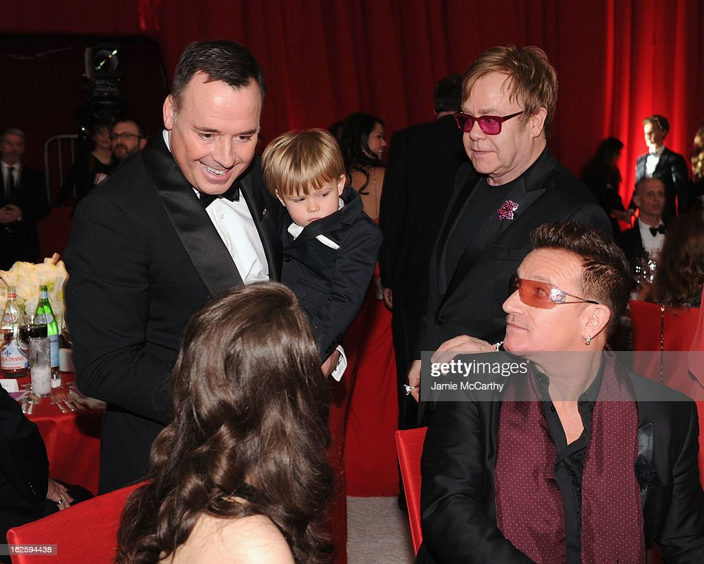 David Furnish, Zachary Furnish-John, Sir Elton John, singer Bono and Eve Hewson attend the 21st Annual Elton John AIDS Foundation Academy Awards Viewing Party at West Hollywood Park on February 24, 2013 in West Hollywood, California.