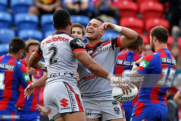 David Fusitu'a of the Warriors celebrates a try with his team during the round 14 NRL match between the Newcastle Knights and the New Zealand...