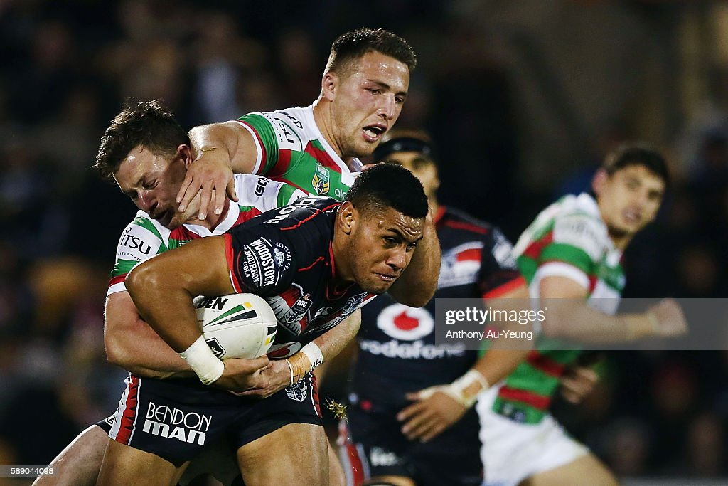 David Fusitu'a of the Warriors is tackled by Damien Cook of the Rabbitohs during the round 23 NRL match between the New Zealand Warriors and the South Sydney Rabbitohs at Mount Smart Stadium on August 13, 2016 in Auckland, New Zealand.