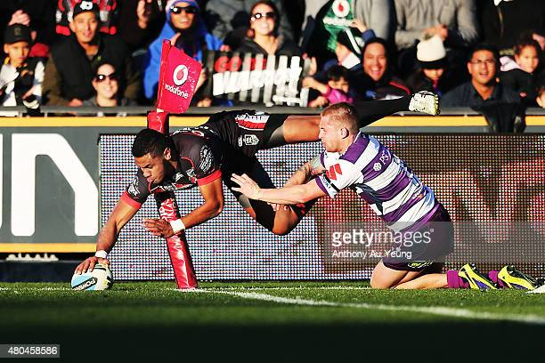 David Fusitu'a of the Warriors scores a try against Cameron Munster of the Storm during the round 18 NRL match between the New Zealand Warriors and...