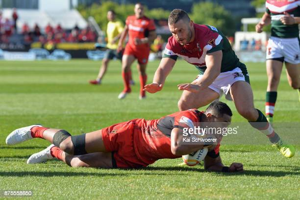 David Fusitu'a of Tonga dives over to score a try during the 2017 Rugby League World Cup Quarter Final match between Tonga and Lebanon at AMI Stadium...