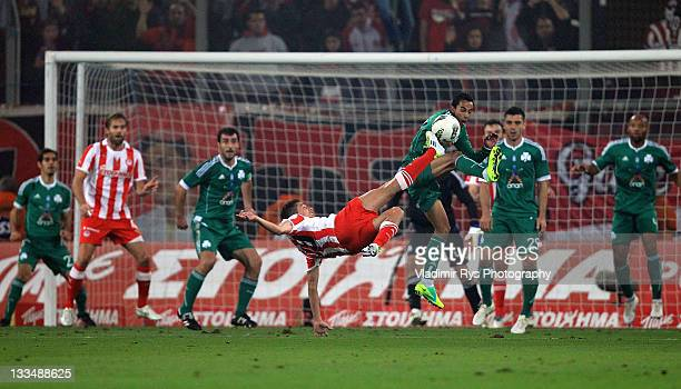 David Fuster of Olympiacos shoots as Zeca of Panthinaikos defends during the Super League match between Olympiacos Piraeus and Panathinaikos FC at...