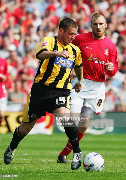 David Galbraith of Boston United is put under pressure by Danny Williams of Wrexham during CocaCola Football League Two game between Wrexham and...