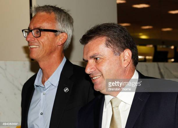 CEO David Gallop and Australian Coach Ange Postecoglou prepares to depart for Brazil ahead of the 2014 FIFA World Cup at Sydney International Airport...