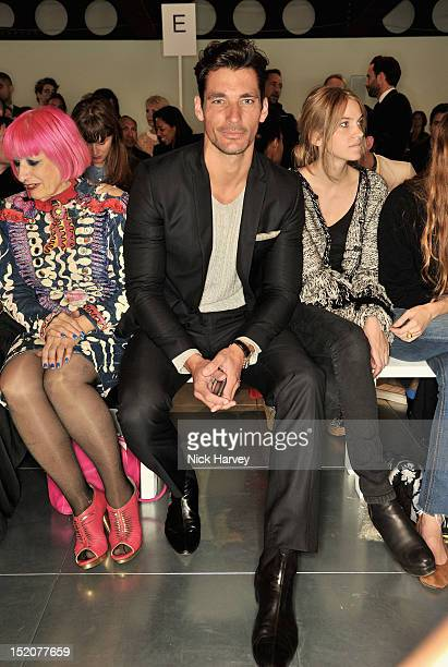 David Gandy and Georgie Macintyre attends the front row for the Matthew Williamson show on day 3 of London Fashion Week Spring/Summer 2013 at Cannon...