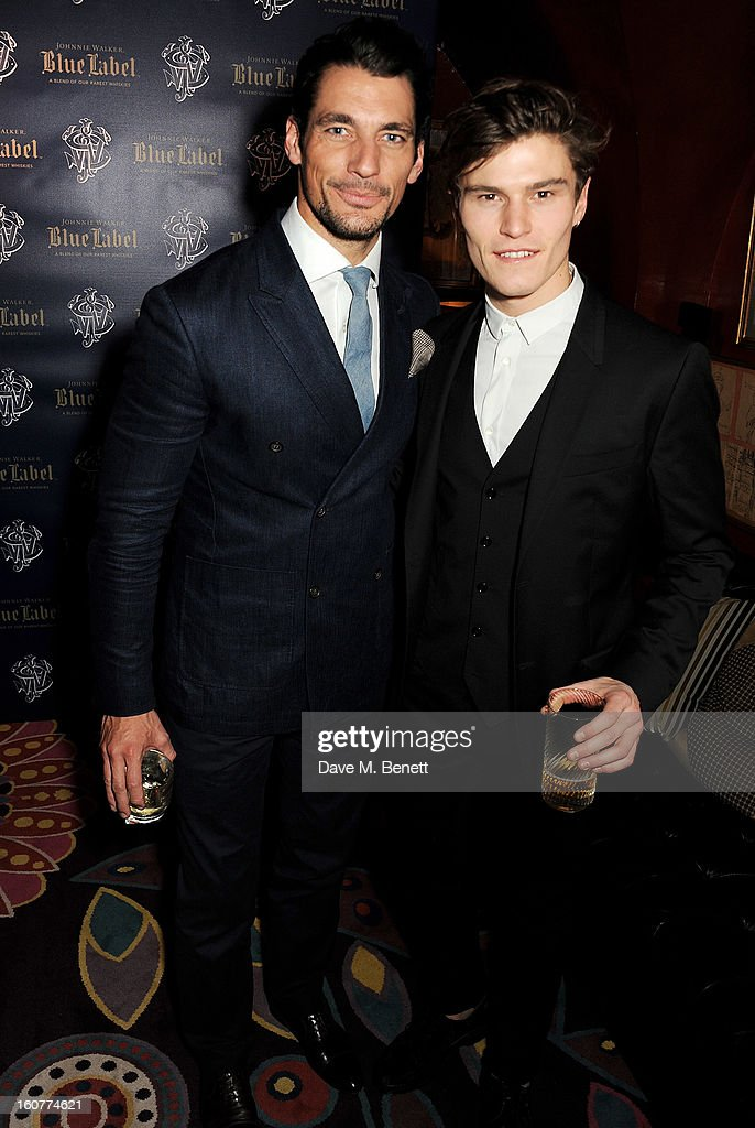 David Gandy (L) and Oliver Cheshire attend a party celebrating the new partnership between Johnnie Walker Blue Label and model David Gandy at Annabels on February 5, 2013 in London, England.