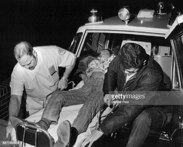 David Garcia Wounded By A Denver Policeman Is Carried From An Ambulance Attendants Bob Streeter left and Brett Johnson move Garcia into Denver...