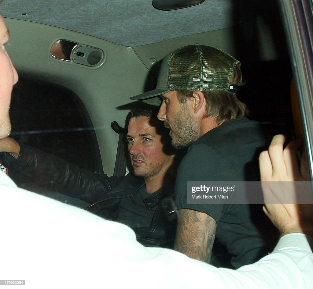 David Gardner and <a gi-track='captionPersonalityLinkClicked' href=/galleries/search?phrase=David+Beckham&family=editorial&specificpeople=158480 ng-click='$event.stopPropagation()'>David Beckham</a> leaving Bodo's Schloss restaurant and bar on September 5, 2013 in London, England.
