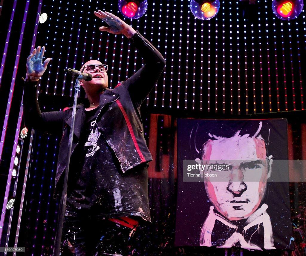 David Garibaldi performs and paints Justin Timberlake at the Universal CityWalk's 'Music Spotlight Series' World Of Dance at Universal CityWalk on August 31, 2013 in Universal City, California.